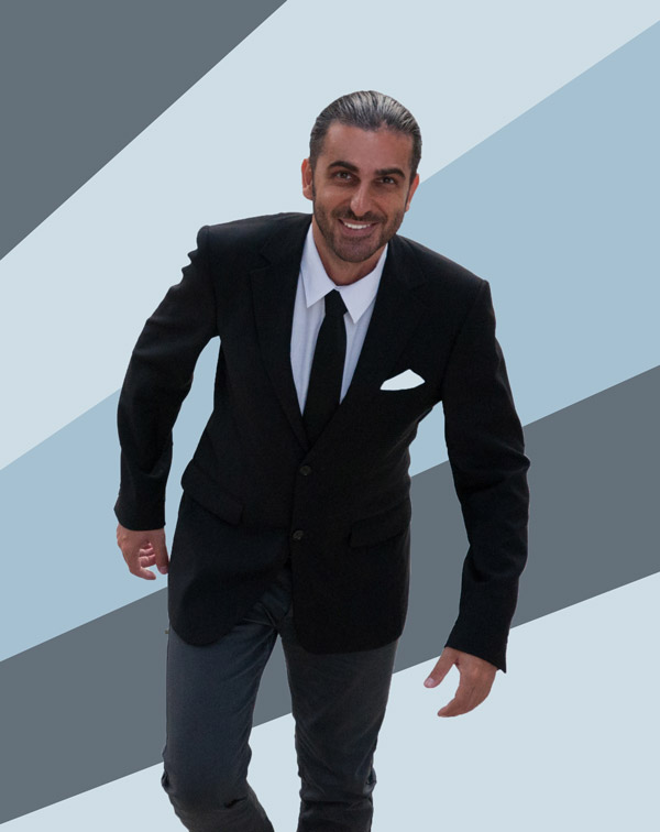 Portrait photo of Matin Akravi smiling in black suit. Pastel blue and Columbia blue colored rectangles placed diagonally with photo editing in the background.